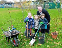 Crabtree Farm pupils and Matt Youdale plant the school's first orchard tree